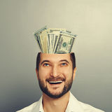 Businessman looking up at money Royalty Free Stock Photography