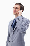 Businessman looking up while on the phone Stock Photos