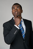 Businessman looking up and thinking royalty free stock images