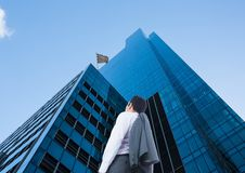 Businessman looking up to see the checker flag in a building Stock Photos