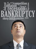 Businessman looking up in word cloud of bankruptcy Stock Photography