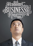 Businessman looking up in word cloud of business Stock Photography