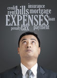 Businessman looking up in word cloud of expenses Stock Photos