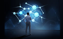 Businessman looking at virtual molecule projection. Business, people, technology and science concept - businessman looking at virtual molecule projection over Stock Photo