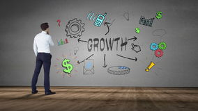 Businessman looking at wall with growth brainstorm stock footage