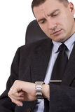 Businessman looking watch Stock Photography