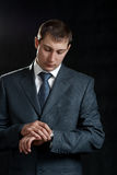 Businessman looking at watch Royalty Free Stock Photography