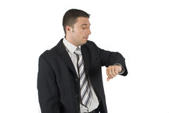 Businessman looking at watch royalty free stock image