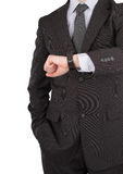 Businessman looking at watch Stock Images