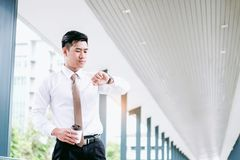 Businessman looking at watch he looks on the time.  stock photo