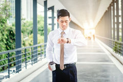 Businessman looking at watch he looks on the time.  royalty free stock photography