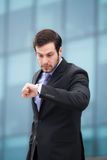 Businessman looking at watch Royalty Free Stock Images