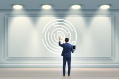 The businessman is looking for ways to escape from maze labyrinth. Businessman is looking for ways to escape from maze labyrinth Royalty Free Stock Photos
