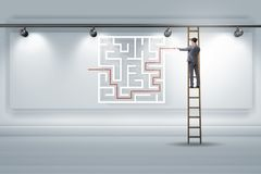 The businessman is looking for ways to escape from maze labyrinth. Businessman is looking for ways to escape from maze labyrinth Stock Photo