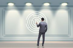 The businessman is looking for ways to escape from maze labyrinth. Businessman is looking for ways to escape from maze labyrinth Royalty Free Stock Photography