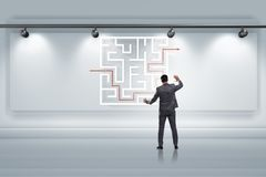 The businessman is looking for ways to escape from maze labyrinth. Businessman is looking for ways to escape from maze labyrinth Stock Images