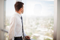 Businessman looking at a window Royalty Free Stock Photography