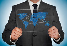 Businessman looking at world map Royalty Free Stock Photography