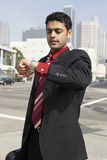 Businessman Looking At Wristwatch On City Street Royalty Free Stock Photos