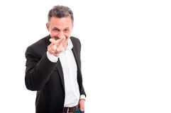 Businessman is looking at you and smiling Stock Photography