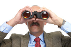 The businessman looks in the binoculars Royalty Free Stock Image