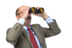 The businessman looks in the binoculars Stock Images