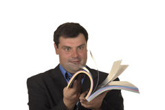 Businessman looks book Stock Photos