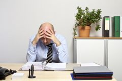 Businessman looks desperately on his folder Stock Photo