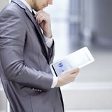 Businessman looks at digital tablet screen with the digital schedule.  royalty free stock photos