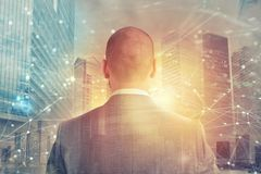 Businessman looks far for the future with internet network effect Royalty Free Stock Photo