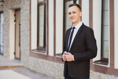 Businessman looks and smiles Royalty Free Stock Images