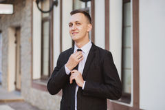 Businessman looks and smiles Royalty Free Stock Image