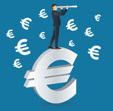 Businessman looks through a telescope standing on Euro icon Stock Photos