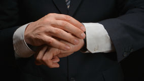 Businessman looks time on a wrist watch Royalty Free Stock Photos