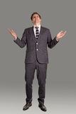 The businessman looks upward. The businessman raised hands and with entreaty looks upward royalty free stock image