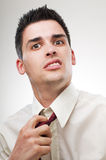 Businessman Loosening Tie Royalty Free Stock Photography