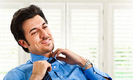 Businessman loosing collar Royalty Free Stock Image