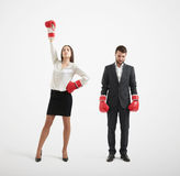 Businessman loser and winner businesswoman. In red boxing gloves over light grey background Royalty Free Stock Photo