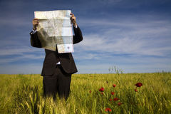 Businessman lost in field