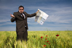Businessman lost in field Stock Images