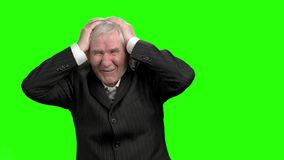 Businessman lost money, slow-motion. Bad investment or economic crisis old man in suit expressions, green hromakey background stock video footage
