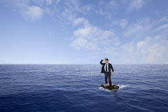 Businessman lost at sea. Inside a travel bag Stock Images