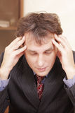 Businessman lost in thoughts Stock Photo