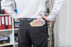 Businessman with a lot of banknotes in his pocket Royalty Free Stock Image