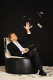 Businessman with a lot of money Royalty Free Stock Photo