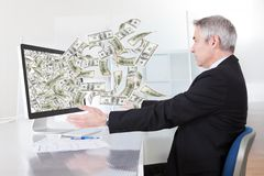 Businessman With Lots Of Cash Stock Photo