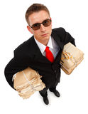 Businessman with lots of paperwork Stock Photo