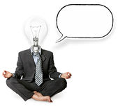 Businessman in lotus pose. And lamp-head with thought bubble Royalty Free Stock Photography