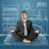 Businessman in lotus pose Stock Photography