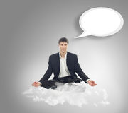 Businessman in lotus position on a cloud Stock Images